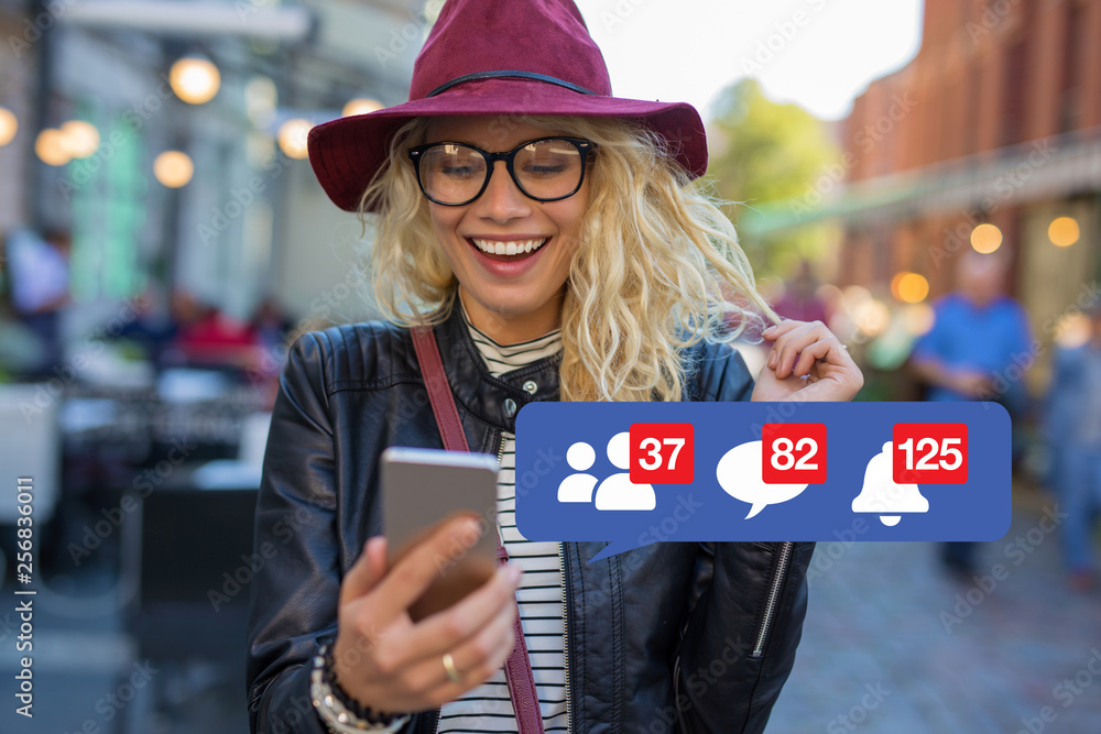 Fototapeta Woman excited about getting attention on social media
