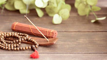 Stick Holder With  Burning Incense Stick  And Mala Beads For Meditation And Relax.