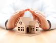 canvas print picture - Property insurance. House miniature covered by hands.