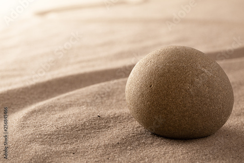 Acrylic Prints Stones in Sand zen stone and sand garden. Concept for relaxation meditation purity spirituality and balance. Rock and lines spa wellness background