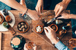 canvas print picture - high angle view of hands picking up food from a table: togetherness, friendship, appetizer, aperitif, tapas moment concept