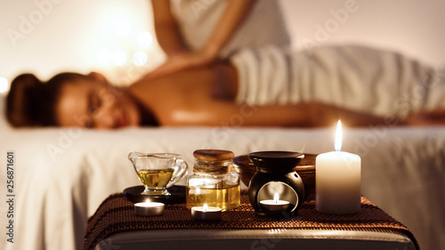 Fototapeta Relaxed woman enjoying aromatherapy massage in luxury spa obraz
