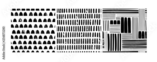 Various lines and shapes. Stamp texture. Set of three black and white abstract seamless patterns. Hand drawn vector illustration. Every pattern is isolated