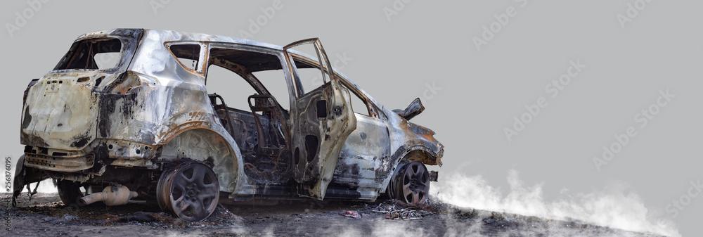 Burnt new car. Isolated on grey background. - obrazy, fototapety, plakaty