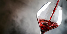 French Dry Red Wine, Pours Into Glass, Gray Background, Banner, Selective Focus