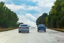 Car Traffic And Big Road Signs...