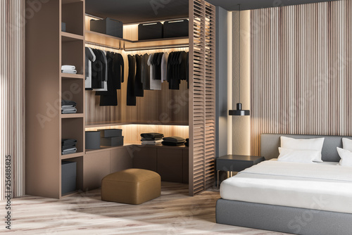 Fototapeta Wooden master bedroom corner with wardrobe obraz
