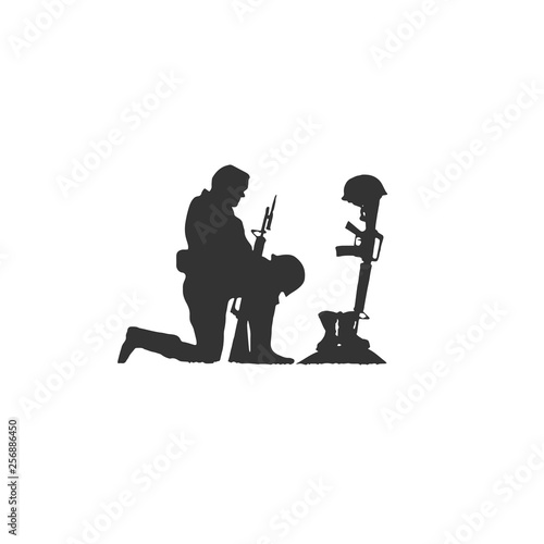 Obraz Isolated Silhouette of Soldier Kneeling at Military War Memorial of Fallen Soldier with Helmet Gun and Rifle in Combat Boots - fototapety do salonu