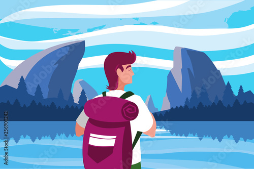 adventurous man with travelbag in the snowscape Canvas Print