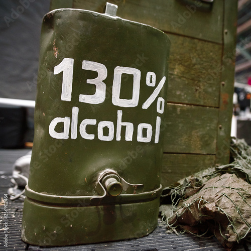 Fotografía  Vintage army canteen and flask labeled alcohol 130 percent