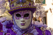 Italy, Venice, carnival 2019, typical masks, beautiful clothes, posing for photographers and tourists.