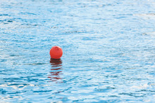 Buoys On The Sea. Fencing On The Water. Red Buoy On The Lake. Safe Swimming Area