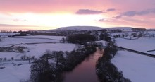 Drone Shot Of Dramatic Sunrise Over A Snowy Valley.