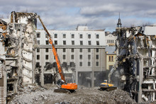 Building Of The Former Hotel Demolition For New Construction, Using A Special Hydraulic Excavator-destroyers. Complete Highly Mechanized Demolition Of Building Structures. Construction Site Concept