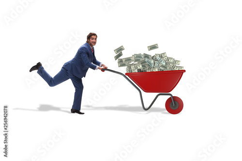 Photo Businessman pushing wheelbarrow full of money