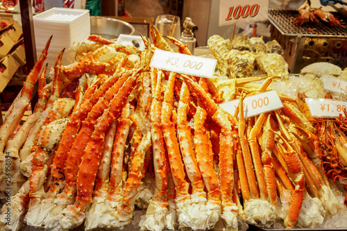 Fotografie, Obraz  Lots of burned king crab legs ready to serve for customer with labels price at Kuromon market, Osaka, Japan