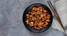Teriyaki Chicken's  With  Sesame Seeds. Spicy Chicken In Sweet And Sour Sauce With Chili Pepper. Chinese Cuisine, Copy Space, Recipe Background, Food Flat Lay, Menu Of Japanese Restaurant