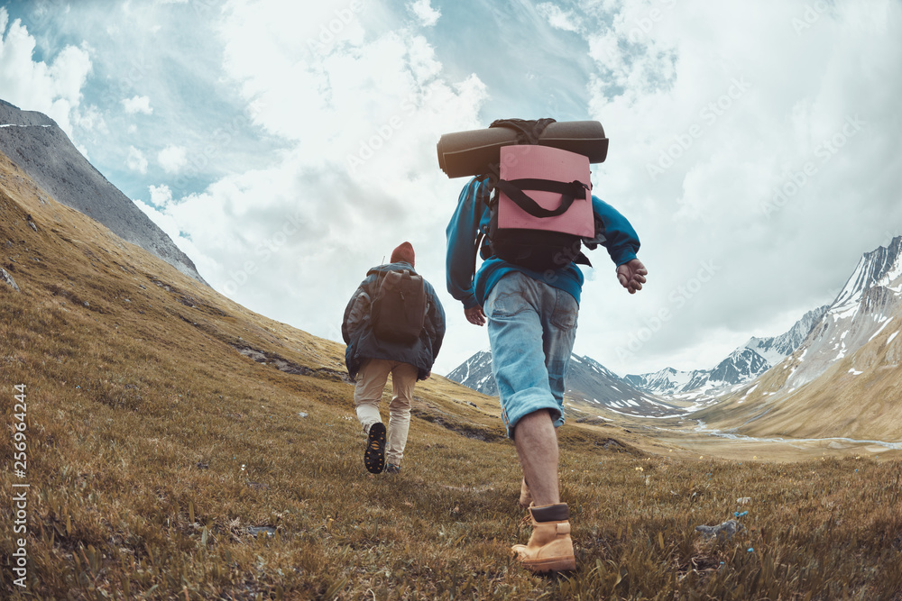 Fototapety, obrazy: Two hikers goes uphill in mountains