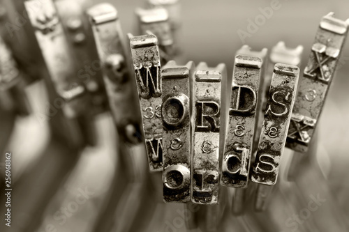 Photo sur Toile Positive Typography the words WORDS with old typewriter keys macro