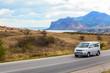 Minibus moves along the road along the sea