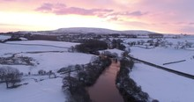 Colorful Sunrise Over A River And Snow Covered Valley In Wensleydale, North Yorkshire.