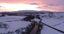 Colorful Winter Sunrise In Snow Covered Wensleydale, North Yorkshire.