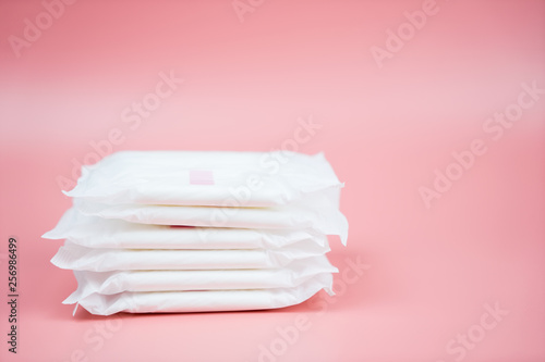 Carta da parati  Stacked sanitary napkin pad on pink background.