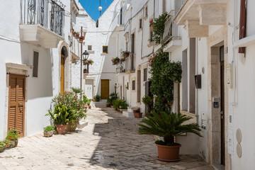 Walking in Locorotondo. Narrow streets and white houses. Dreamlike Puglia, Italy