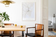 Leinwanddruck Bild - Stylish and eclectic dining room interior with mock up poster map, sharing table design chairs, gold pedant lamp and elegant sofa in second space. White walls, wooden parquet. Tropical leafs in vase.