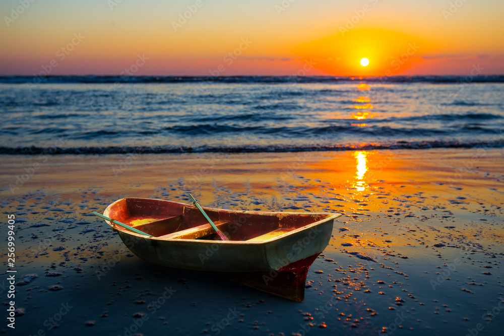 Fototapety, obrazy: small rowing boat on a sea coast at the early morning