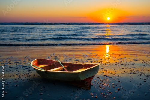 small rowing boat on a sea coast at the early morning