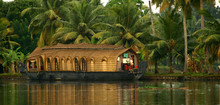 Houseboat With Palms In Background At Backwaters India