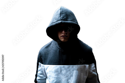 Fotomural  anonymous man in the dark hood standing in the mysterious pose f