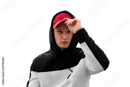 Cuadros en Lienzo stylish man in the hood in urban city, modern fashion clothes concept f