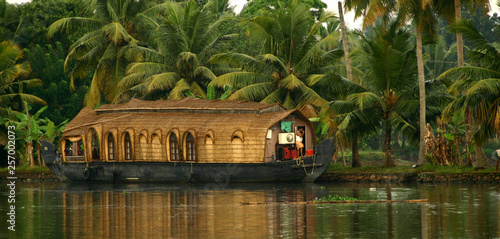 Photo Houseboat with palms in background at Backwaters India