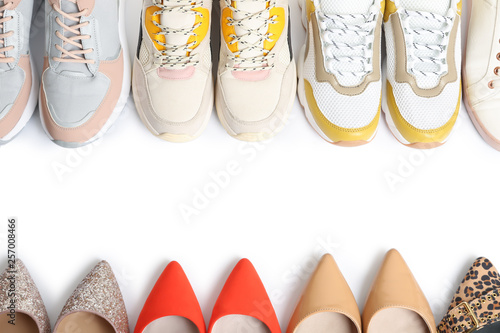 Photo  Frame of different shoes on white background, top view with space for text