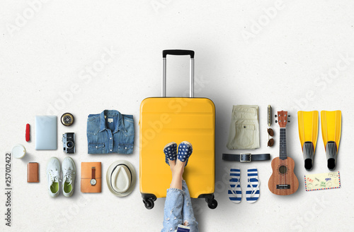 Canvas Print Travel concept with a large suitcase and other accessories