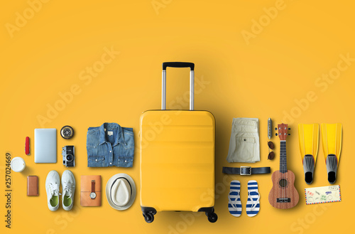 Travel concept with a large suitcase and other accessories