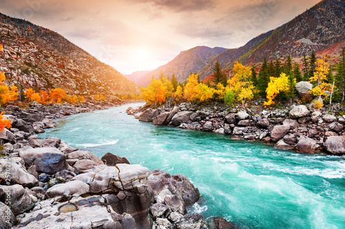 Foto auf Leinwand Orange Katun river in autumn mountains at sunset. Altai, Siberia, Russia