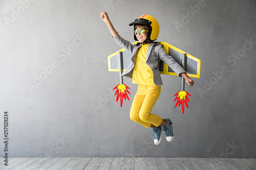 Fotografie, Obraz  Happy child playing with toy jetpack