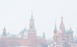 Winter day. Heavy snowfall. Blizzard. Spasskaya Tower of Moscow Kremlin and the Cathedral of Vasily the Blessed (Saint Basil's Cathedral) on Red Square. Moscow. Russia