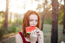 Happy Young Woman Eating Water...