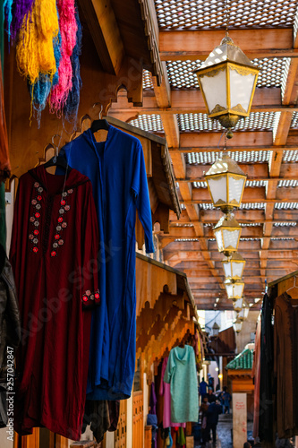 Hanging Lights and Clothing for Sale in the Medina of Fez