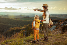 Modern Mother And Child Hikers Pointing At Something