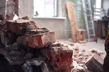 Repair And Construction Of The House. Broken Brick Wall Indoors Closeup.