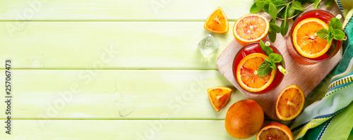 Fototapeta Bloody orange drink and ingredients, copy space obraz