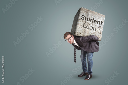 Fotomural  Concept of a man in a suit bending under the burden of a student loan