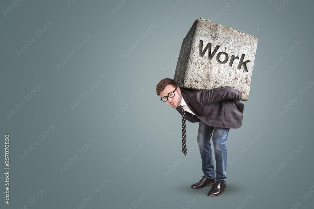 Fototapeta Concept of an entrepreneur bending under a heavy workload
