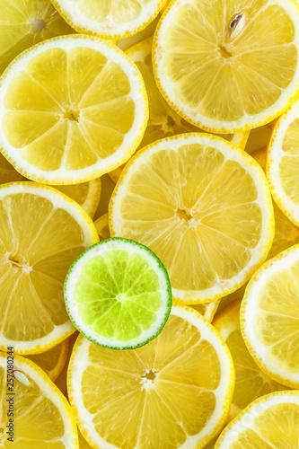Spoed Foto op Canvas Plakjes fruit Lemon slices with one cut lime slice closeup