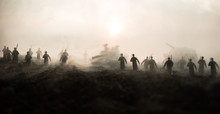 War Concept. Military Silhouettes Fighting Scene On War Fog Sky Background, World War Soldiers Silhouettes Below Cloudy Skyline At Sunset. Attack Scene. Armored Vehicles.